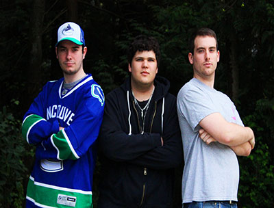 Chris Cameron, Edward Puckering and Kevin Smith smiling and facing the camera.