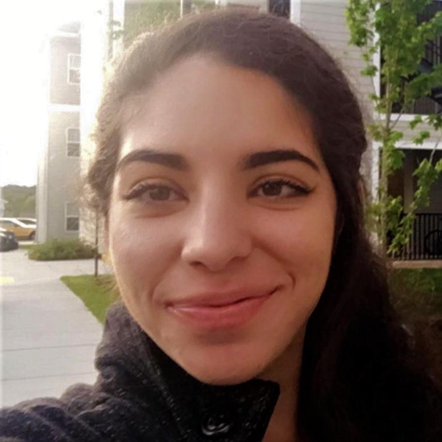 Gabriela Cintron smiling and facing the camera.