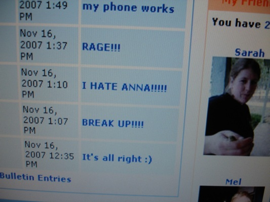 "A computer screen displays a series of emotional social media posts with subject lines such as ""Rage!!!"", ""I HATE ANNA!!!!!"", and ""It's all right : )""."