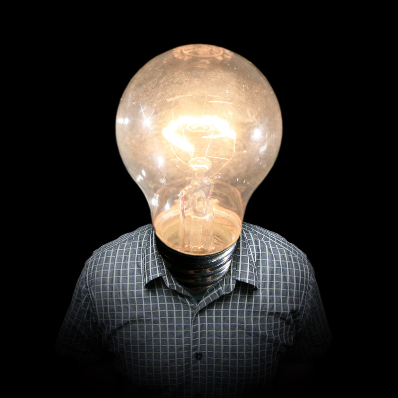 A person with a light bulb in place of a head.