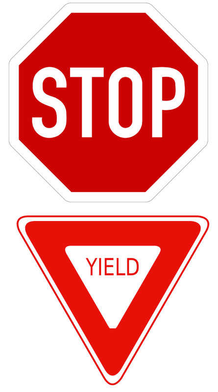 A stop sign and a yield sign.
