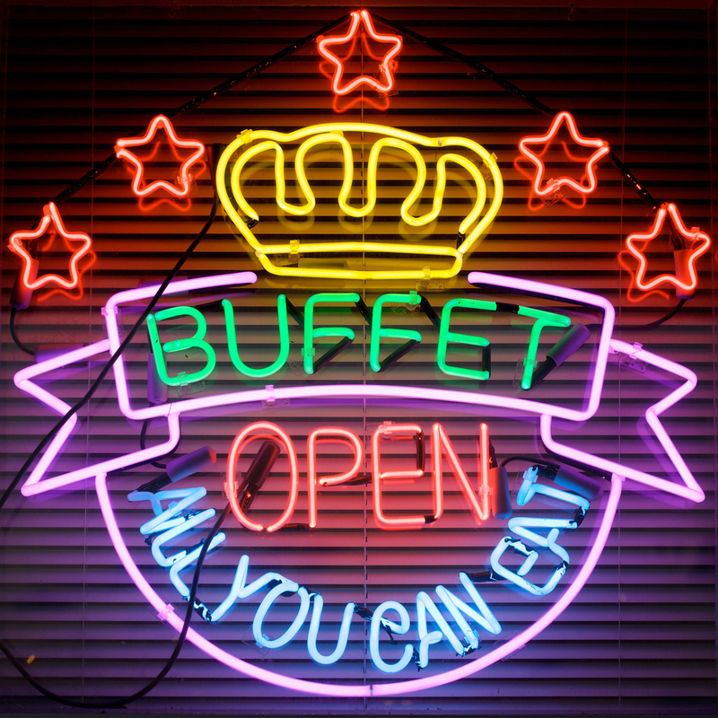 A neon sign advertises an all-you-can-eat buffet.