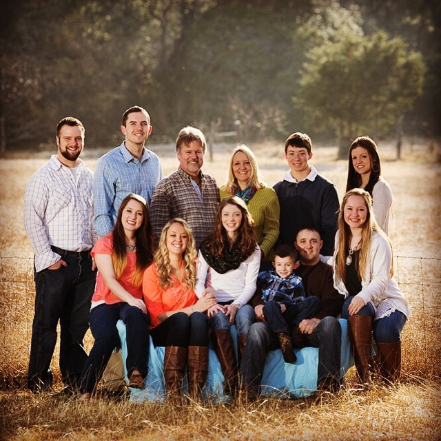 Portrait of a happy blended family including ten children.