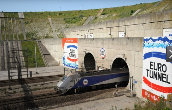 A train exits the Channel Tunnel.