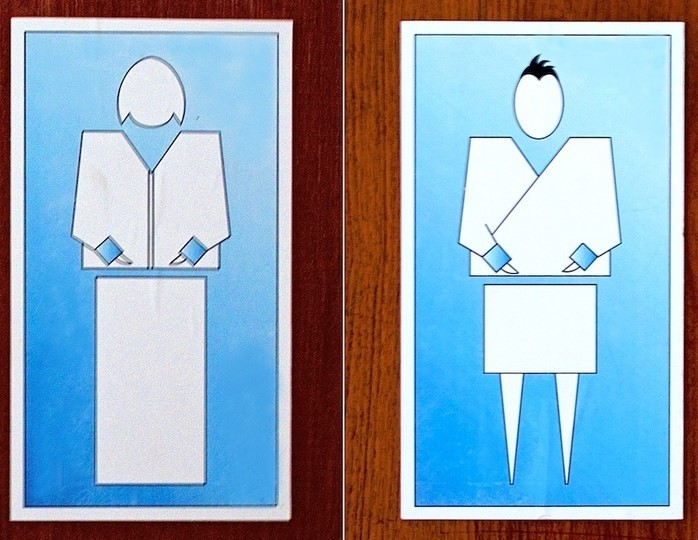Restroom signs from the country of Bhutan display stylized representations of a woman and man dressed in traditional clothing.