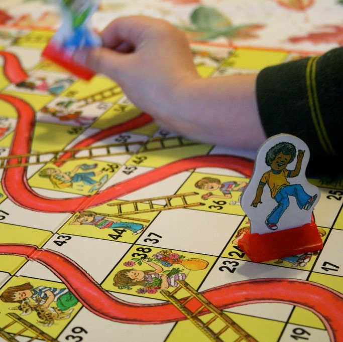 Children playing the game Chutes and Ladders.