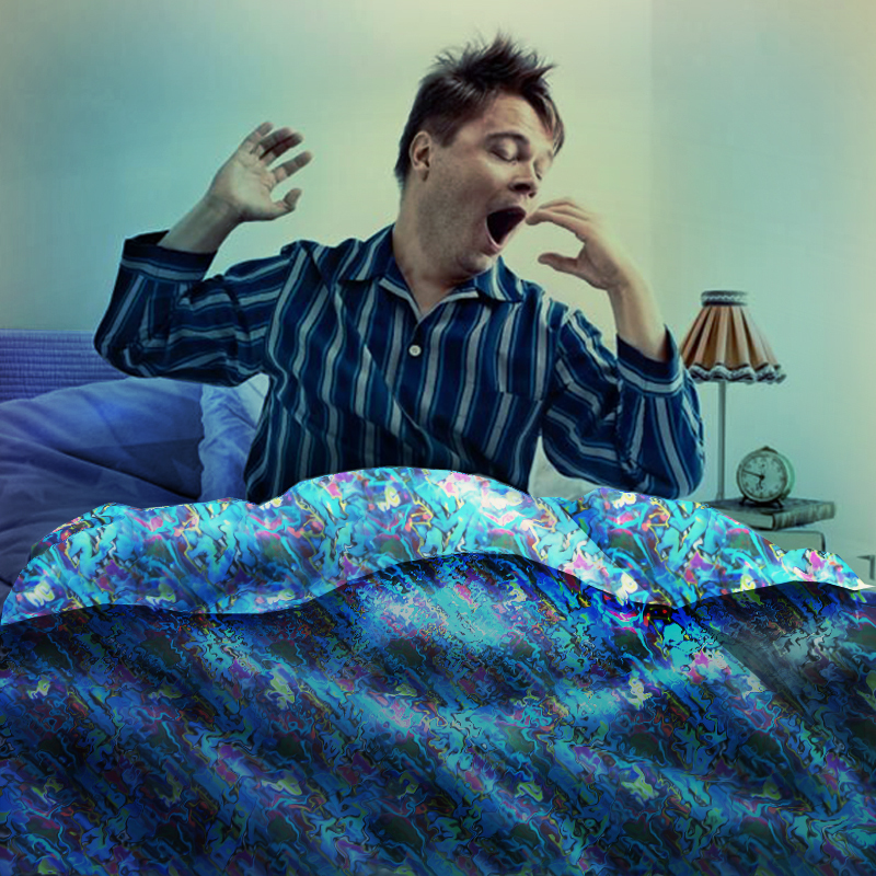 A man dressed in pajamas sits up in bed as he stretches and yawns.
