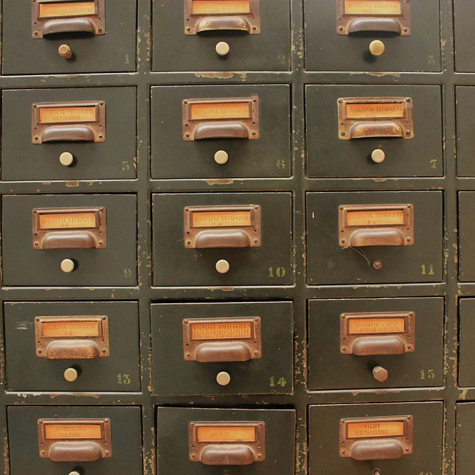 A series of numbered file drawers like those that were common in libraries.