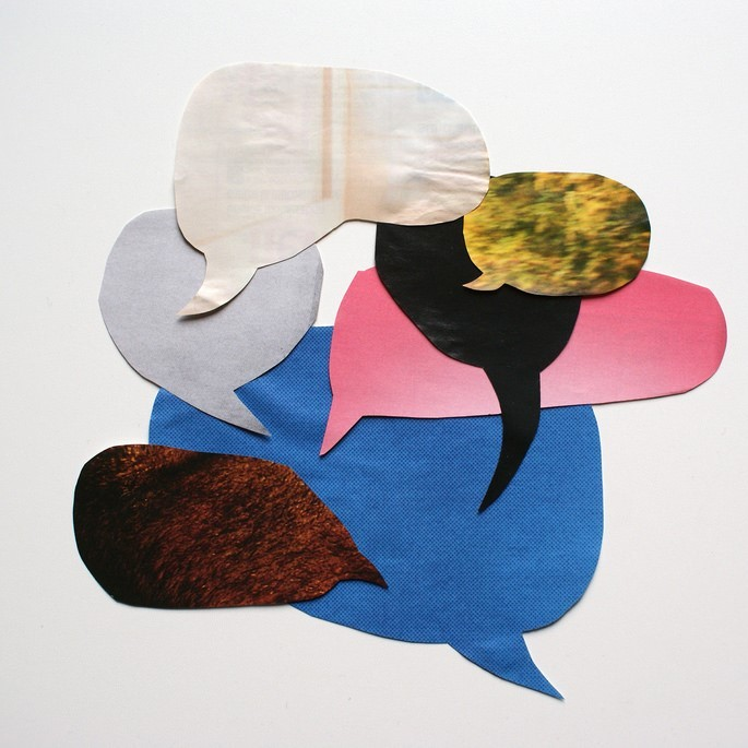 """An artwork titled """"Graphic Conversation"""" made up of speech balloons like those often used in cartoons."""