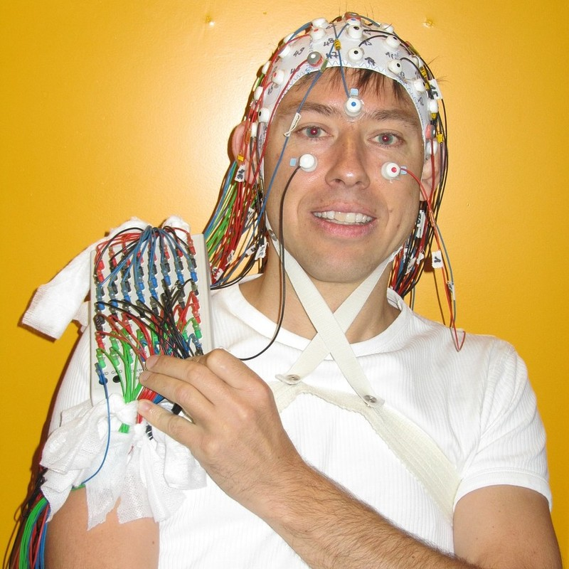 Man wearing an EEG cap.