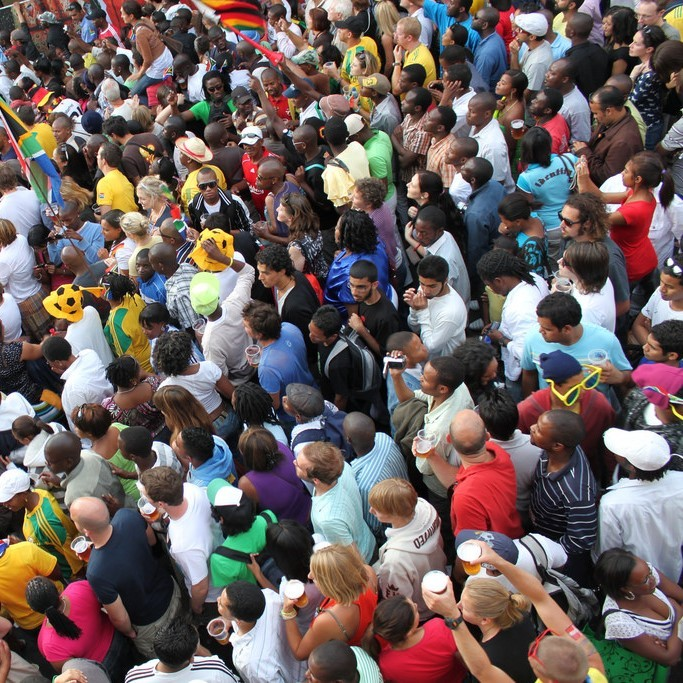 A huge crowd of people stand shoulder to shoulder during the 2010 World Cup.