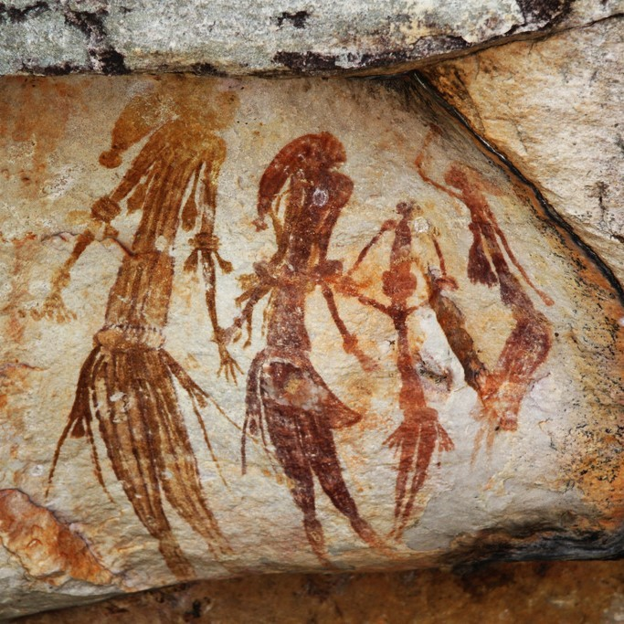 Cave paintings from Western Australia appear to show an ancient family dressed in traditional clothes.
