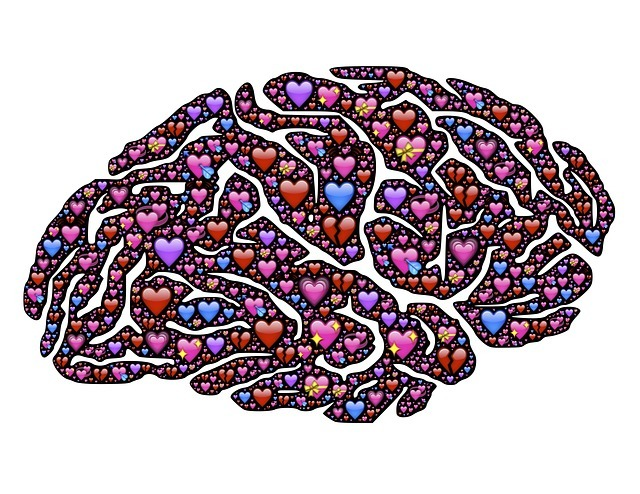 An illustration of hundreds of small heart forming the shape of a brain.