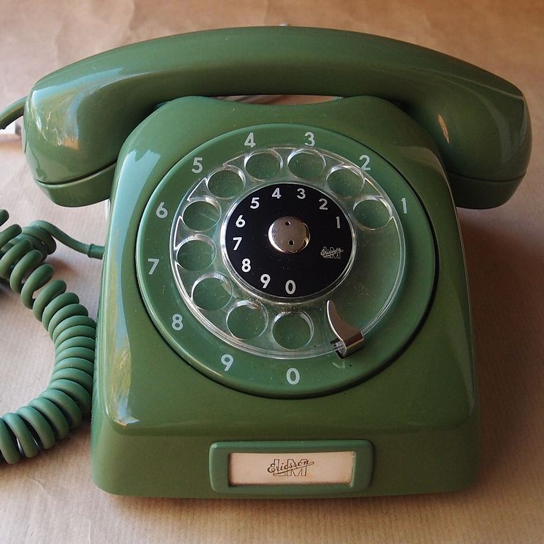 A rotary dial telephone.