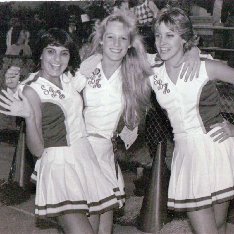 Cheerleaders pictured in a 1980s high school yearbook.