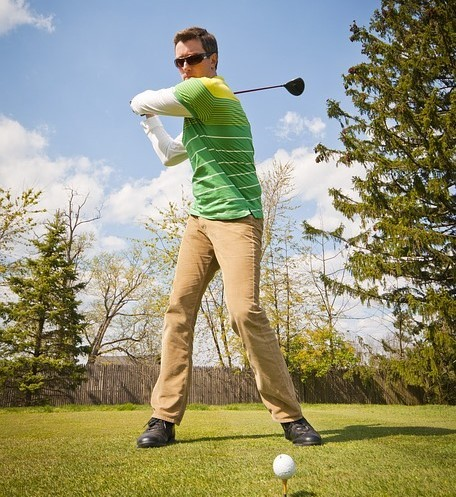 A golfer prepares to tee off.