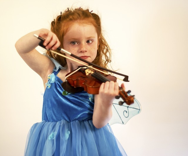 A young girl practicing the violin.