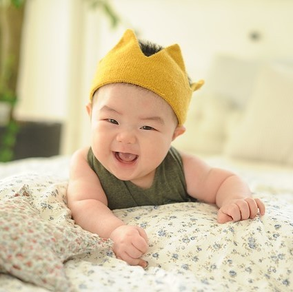 An adorable smiling infant.