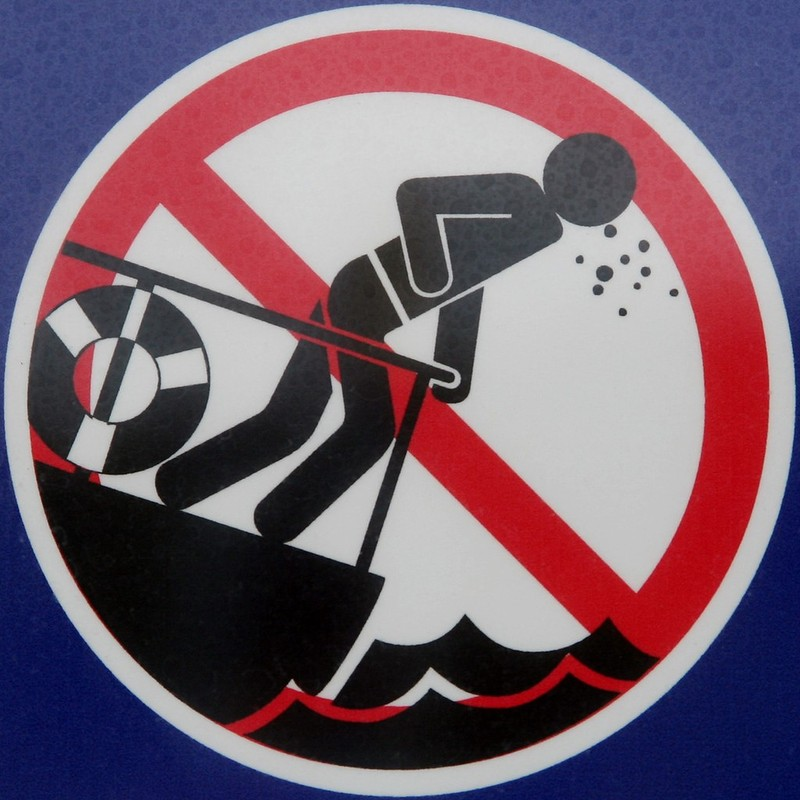 Warning sign at a carnival that those who easily experience motion sickness should not go on this ride.