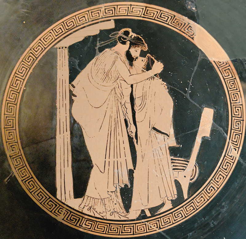 An image on an ancient Greek drinking cup of two lovers kissing. c.a. 480 BC.