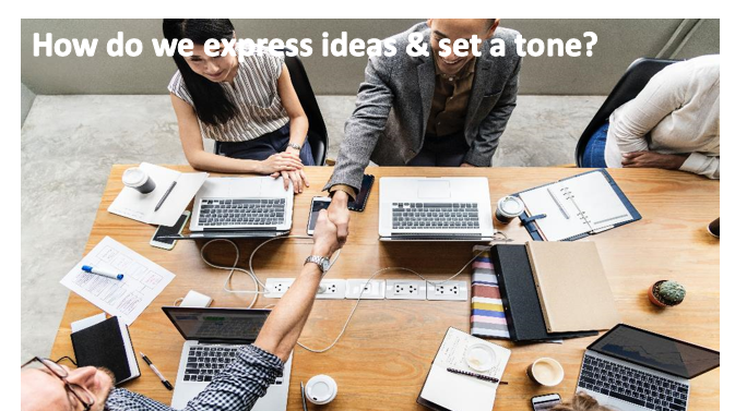 "An image of people sitting around the table, two of the people are sitting across the table from each other and shaking hands. An image caption reads: ""How do we express ideas & set a tone?"""