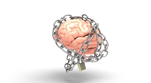 Image of a brain, wrapped with a chain and a lock