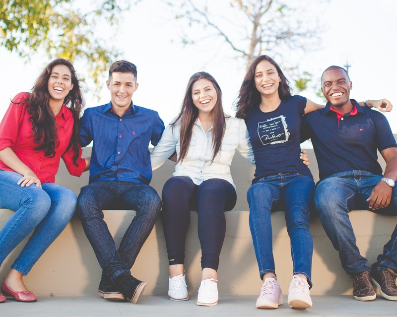 An image of young people smiling at the camera