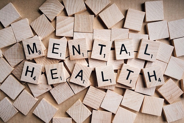 "An image of small wooden tiles that spell out ""Mental Health""."