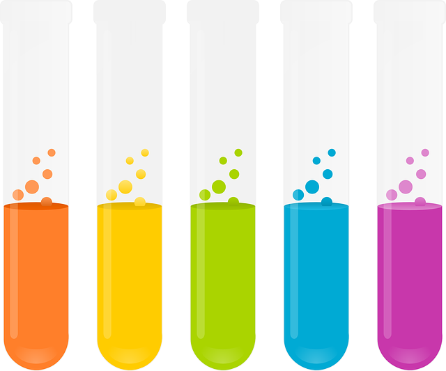 An image of five test tubes with substances of varying colors bubbling inside them