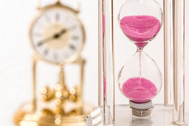 An image of an hourglass and a clock